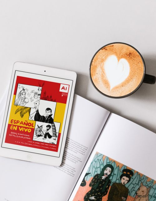 White iPad with coffee and book